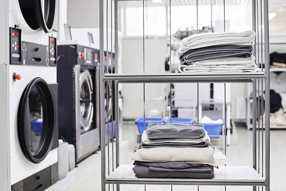 Clean stuff is on the rack at the dry cleaners